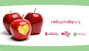 Three red apples, once with bites taken out in the shape of a heart advertising red apple day org