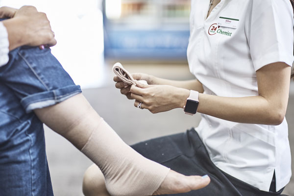 Person being fitted with a lower leg compression garment