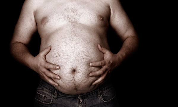 Close up of man's hands on his large stomach