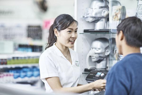 Pharmacist advising a man on sleep apnoea treatments