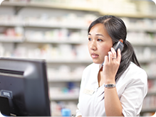 Pharmacist speaking on phone with customer