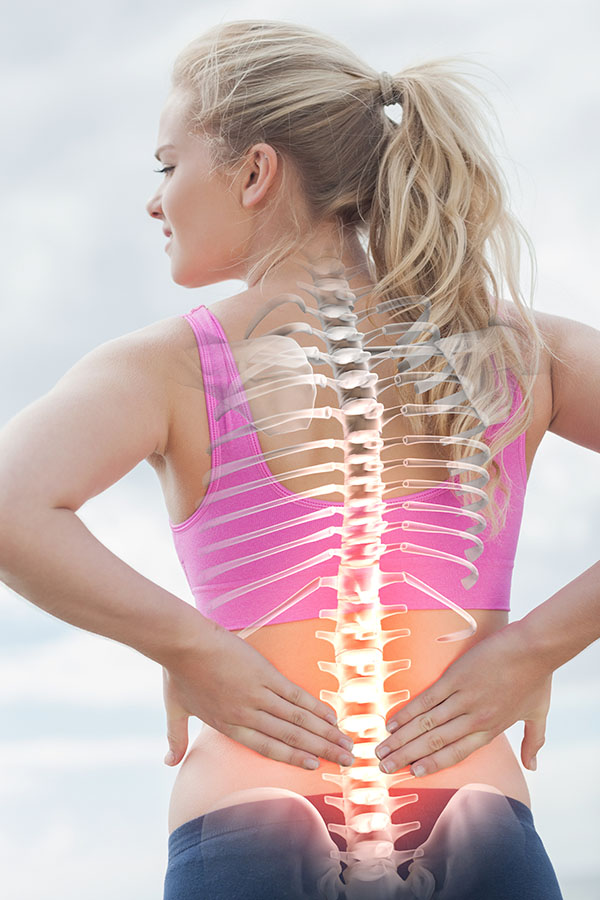 Superimposed back bones on a woman as she faces away from us